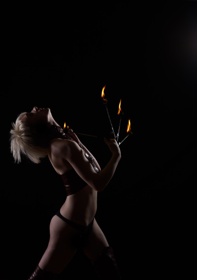 My favourite promo shot from my fire burlesque; because some of the others don't do the fact that I actually burn pieces of the outfit off of my body justice.FireLight Arts PhotographyFire Burlesque Created, Costumes, and Performed by Me, Poisonne.