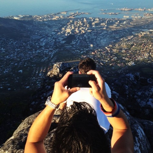 instagram:   Spotlight: South Africa Since launching, we've seen Instagram spread from our headquarters in the Bay Area to every corner of the globe. In this series, Spotlight, we'll highlight top users from countries and cities with thriving Instagram communities. South Africa, the African continent's southernmost country, boasts 11 official languages, three capital cities and some of the most photogenic landscapes in the world. Instagrammers both homegrown and from abroad have given outsiders a glimpse into this vast and diverse country, from the Namib desert in the northwest to the subtropical forests in the east to the coastline that stretches over 1700 miles (2700km). Want an insider's view of South Africa? Follow these locals to see the country through their lens. Ofentse Mwase, a cinematographer snapping photos from Johannesburg and its outskirts — @unclescrooch Alessio La Ruffa, taking beautiful photos in and around Pretoria — @alessiolr Ross Pickford, a software developer sharing photos from Cape Town — @roscoedude Gareth Pon, a filmmaker photographing Johannesburg's cityscapes — @garethpon To explore the country in depth, you can also browse the location pages for some of South Africa's most popular destinations: Orlando Towers, art and base jumping at defunct nuclear cooling towers Lion's Head summit, with a spectacular view of Table Mountain Cango Caves, beneath the Swartberg range near the town of Oudtshoorn Knysna Elephant Park, up close and personal with beautiful pachyderms