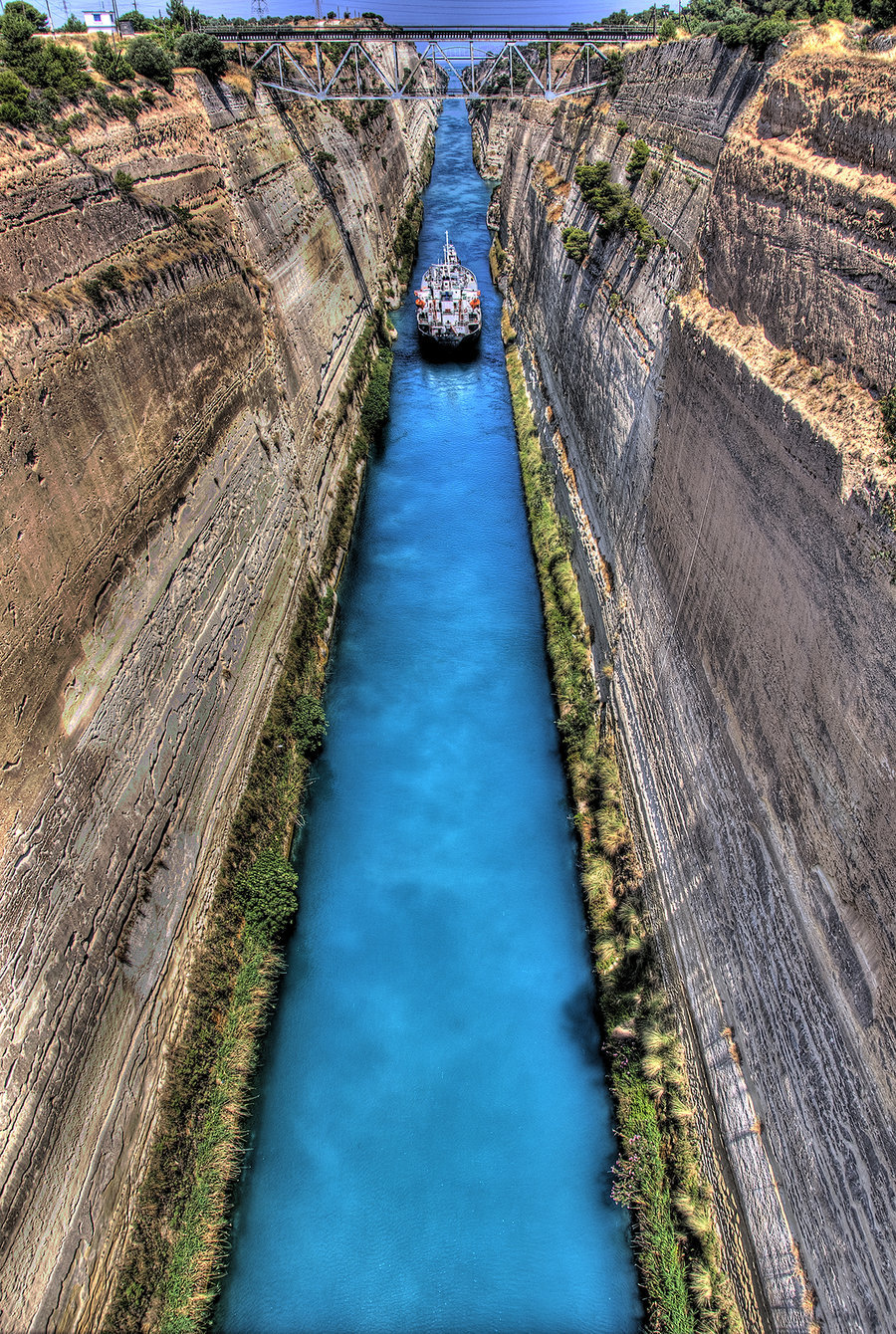gotraveling:  The Isthmus of Corinth Canal, Greece ~by ^StamatisGR A isthmus is a narrow land bridge which connects the Peloponnese peninsula with the mainland.