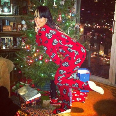 theycallmebk:  don't tell Santa!!! #christmas #onesie #tree #gifts