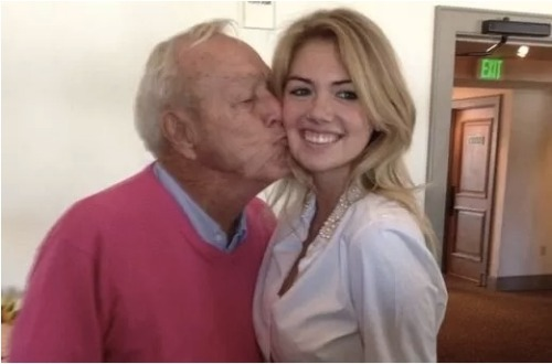 Golf legend Arnold Palmer kissing supermodel Kate Upton… Wait. What?… Click the pic for the full story; but, basically when you're the King of Golf these things happen.
