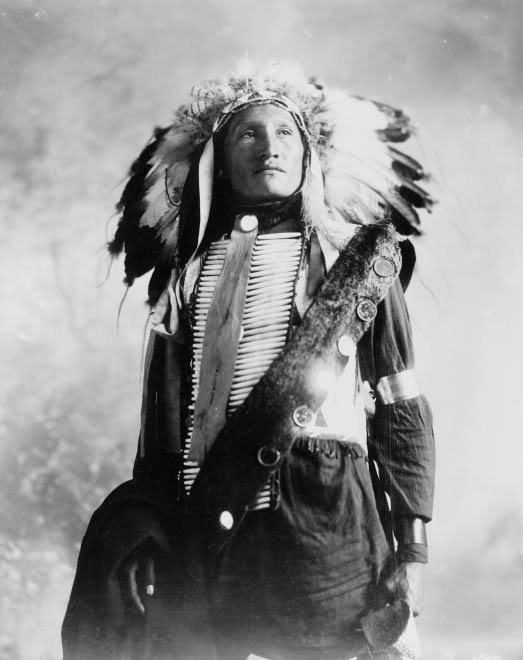 thatsomethingsomething:  Plenty Holes, a Sioux Indian in feather headress and bone breastpiece. click here and press space bar for more chocolatemochacream  love him