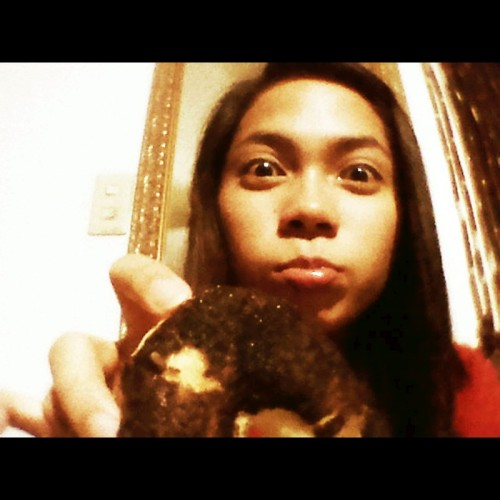Such a doughnut lover.. :D so hard to resist (Photo taken and uploaded via MOLOME )