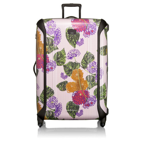Travel accessories brand TUMI and designer Anna Sui have reunited for a second season with a collection of beautiful, lightweight cases and bags in raspberry and pansy hues.