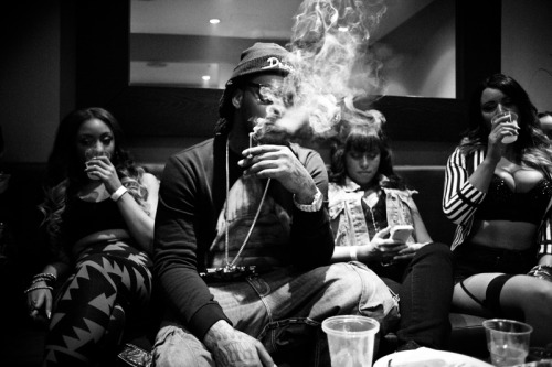 Waka Flocka Flame smokin' surrounded by groupies. backstage in toronto on the triple f life tour. october 2012.  I'm still amazed I was granted permission to hang out and just shoot photos of whatever I wanted. Waka was just so chill.