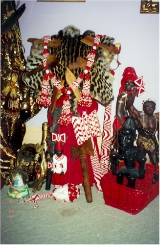 This was my first Godfather's Oju Shango (Face of Shango), with a real leopard skin, in his home in Mount Clemens, Michigan. Afolabí (iba'ye) really knew how to turn out a beautiful Orisha shrine. Kawo! Kabiesile, Babami! (Also, note the Wizard of Oz Dorothy and Glinda snowball on the floor between his Oshun and Shango shrines. Oh, honey, I miss your Wizard of Oz memorabilia obsession! May you rest in ruby red slippers forever and ever. <3)