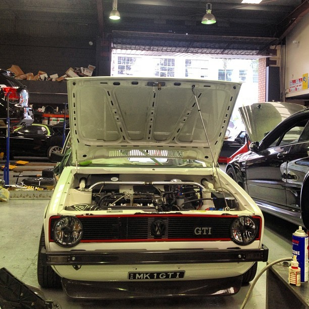 downshiftaus:  A front on shot of the gorgeous Mk1 I posted earlier. Everything about this car is perfect, that carbon lip is amazing. I wish I could have shown you guys the motor/engine bay but its all secret squirrel at the moment. #volkswagen #vw #dublyf #mk1 #golf #rabbit #white #hatch #cage #flawless #immaculate #nothingmissed #carbonfibre #tucked #shaved #euro #hothatch #inlove #cannotwaittilltheownerfinishesit #downshiftaus