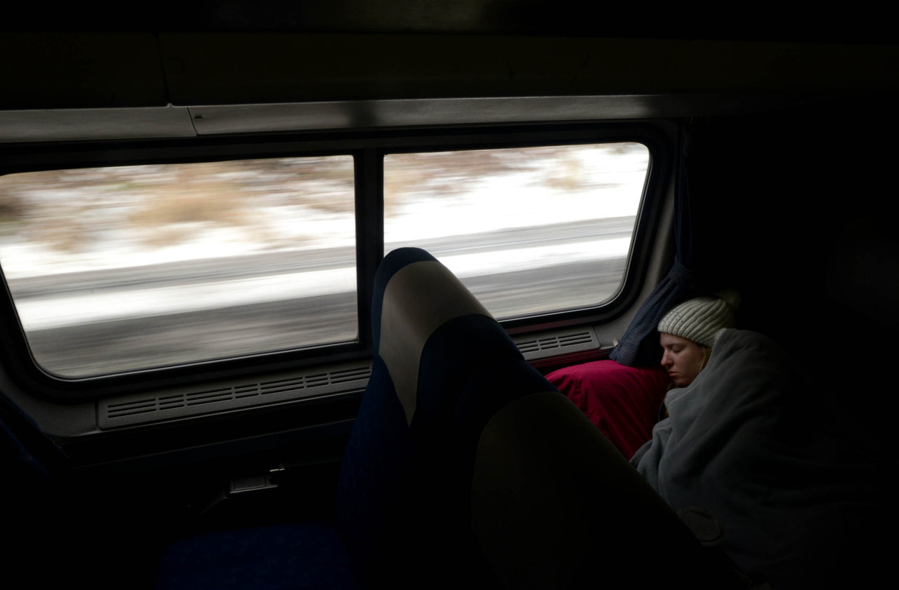 Christy Gressman of Murrysville, Pa. sleeps while riding on the Pennsylvanian, an Amtrak passenger train line that runs between Pittsburgh and Philadelphia, on Wednesday, Feb. 13, 2013.  The line is in danger of being cut in October.   — Michael Henninger Amtrak's regulars treasure the Pennsylvanian  More photos from this story by the PG's Michael Henninger
