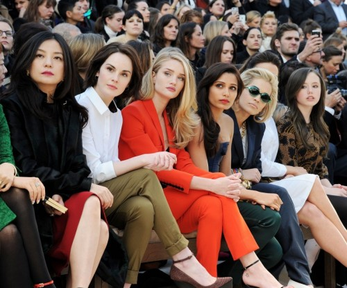BURBERRY PRORSUM A/W 13: THE FRONT ROW Is it shameful to admit we spent a small section of our childhoods practicing our frows? Not teasing our frizzy our manes dear (though we do have super fine ones). We're talking crossing legs and squinting into the middle distance, with a slight open pout so as to suggest interest. No feigning here though. No siree. A fully transfirxed group of VIP's at Burberry: (FROM L-R): Vicky Zhao, Michelle Dockery, Rosie Huntingdon-Whiteley, Freida Pinto, Rita Ora.   www.burberry.com by Vincent Levy