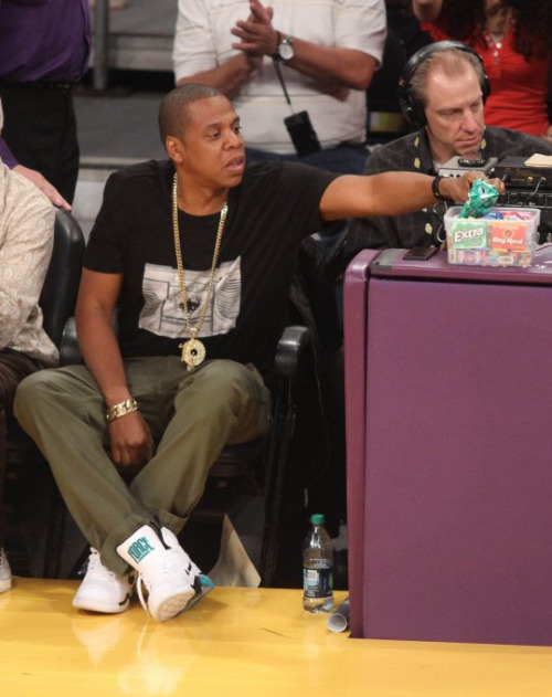 bzcohen:  aintnojigga:  Jay-Z helps himself to candy from the commentators stand, at Sunday's Lakers vs. Thunder game.  all our eyes green  Watch the Toblerone.