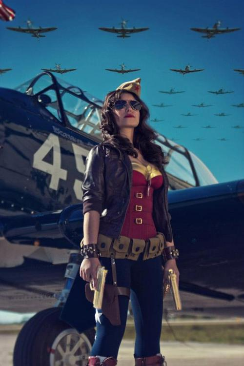 amazon-x:  melifair:  stepchildofthesun:  Amazing WWII Wonder Woman cosplay by Jessica LG  GAH! Perfection!  Rebageling again because LOOK….GOLDEN GUNS OF EROS! Garrison cap as tiara! Utility belt as her golden girdle of Gaia…OMG, the boots are probably perfection as well!