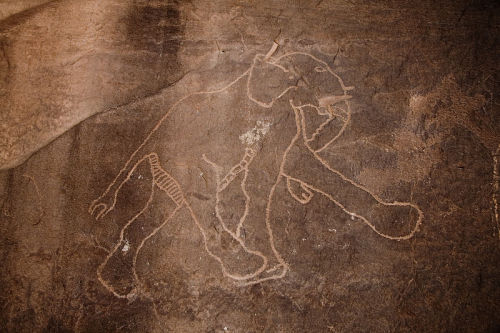 Artists who painted images in caves 30,000 years ago did a pretty good job of depicting the movements of four-legged animals like horses. In fact, they were more skilled than today's artists. Even the modern experts who illustrate animal anatomy textbooks don't match the accuracy of the people who decorated cave walls millennia ago. So says a study reported in Livescience.com. I'd like to suggest this is a useful metaphor for you to consider, Libra. There's some important task that the old you did better than the new you does. Now would be an excellent time to recapture the lost magic.    Man I love Rob Brezny. And anyone that knows me knows exactly what the task is…. Photo of a prehistoric rock carving of an elephant in Libya.