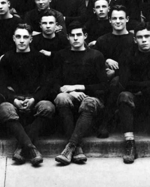 jobskeffington:  Ernest Hemingway, center, photographed for the Oak Park High School football team, November 1915