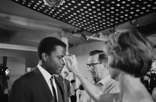 Sidney Poitier getting his make-up touched up on the set of 'To Sir, With Love', in June 1966. Photo by Chris Ware/Keystone Features/Hulton Archive.