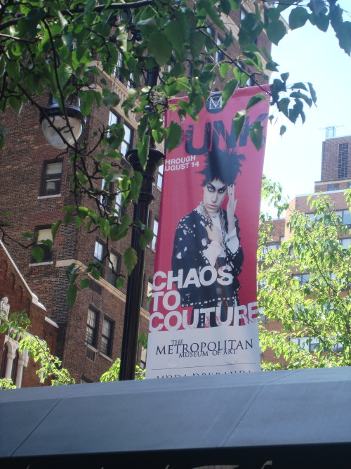Out in the City, NYC 2013  Went to see the PUNK:Chaos to Couture show at the Metropolitan Museum of Art. I literally almost fainted from excitement. I snuck a few photos, but those guards are FAST and the lighting is horrible. It was definitely like being back at CBGBs. I cannot lie- I wasn't just inspired, I was on fire from being in there. The energy in the rooms gets you all hopped up, and seeing Dior, Westwood, Givenchy, Versace, and Rodarte close up and in touching distance made me wild with acquisitive desire. I touched a chain and cashmere Balmain sweater. I'm going back next week.   It was also the first time hanging out with my friend Portia Makoma, who I met when she wss doing PR for the sewing studio. We ended up being photographed by these cool Italians, Mario and Antonella who are building an insanely gorgeous hotel in Bali. We're invited to amble over there next March. And I will make it my business to be on a plane, believe me.   The best thing about having a NY friend like Portia is that she's like some dainty fairy princess that landed ever so delicately amidst the confusion and mess of 5th Avenue. People complemented us left and right, it was super cool. She's the kind of riend who shines so brightly, that you end up shining, too.  Today felt like the day I've been wanting to have since I moved to New York. A little SATC, a little Friends, and a whole lot of magic.