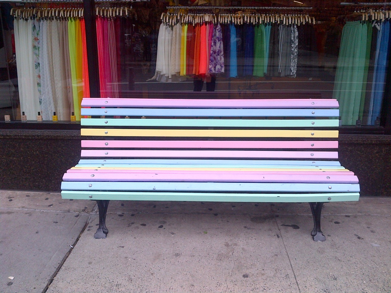 """Rainbow bench outside the American Apparel store on Bleecker Street. I thought it was pretty great so I called up the store. """"Did you do this because of the history of the LGBT movement in the West Village?"""" I asked the lady. """"No, we just wanted to promote our pastel colors."""" Oh."""