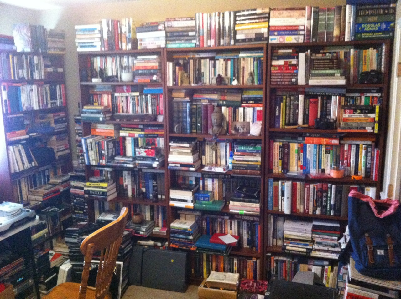 jamaal-terrence: My library is looking kinda thick. I got two more bookcases hiding on the other wall.