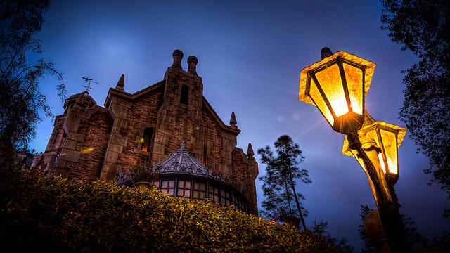 randomwdw:  Magic Kingdom - Stormy Night by SpreadTheMagic on Flickr.  Love me some haunted house!