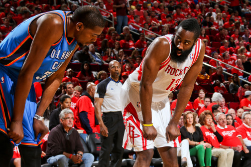 nba:  Kevin Durant of the Oklahoma City Thunder and James Harden of the Houston Rockets wait to resume play in Game Six of the Western Conference Quarterfinals during the 2013 NBA Playoffs on May 3, 2013 at the Toyota Center in Houston, Texas. (Photo by Layne Murdoch/NBAE via Getty Images)