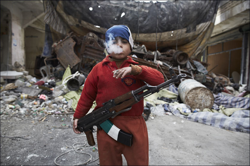 photo by Sebastiano Tomada. A 7 or 8 year old boy in Syria.