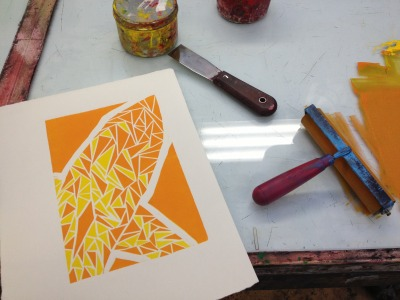 Second color pass of a reductive linocut print.