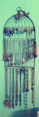 I turned a useless piece of wall art into a cute jewelry holder. I've had that stupid thing hung on my wall for about a month, but only just found the motivation last night to actually put all my jewelry on it.