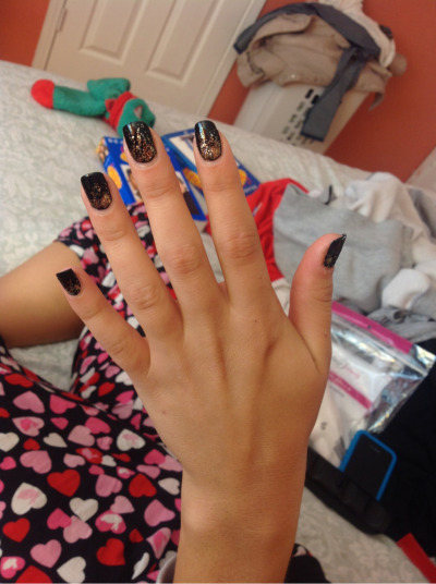 I did my friends nails… These are her natural nails… Black polish with gold gradient glitter :)