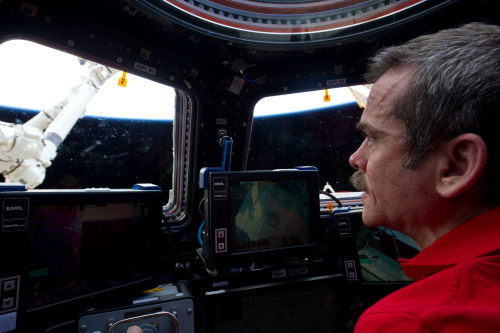 """Commander Chris Hadfield speaks to Fresh Air's Terry Gross about how he and his fellow astronauts meticulously prepare for every disaster scenario as a way of coping with fear:   Half of the risk of a 6 month flight is in the first 9 minutes, so as a crew, how do you stay focused? How do you not get paralyzed by the fear of it? The way we do it is to break down what [the risks are]. And a nice way to keep reminding yourself is, """"What's the next thing that's going to kill me?""""   And it might be 5 seconds away, it might be an inadvertent engine shutdown, or it might be staging of the solid rockets coming off, or it might be some transition or some key next thing, [for example] """"We've already had one computer fail, and we've had one hydraulic system fail, so if these three things fail now we need to react right away or we're done.""""  So we don't just live with that, though. The thing that is really useful, I think out of all of this, is we dig into it so deeply and we look at, """"Okay, so this might kill us, this is something that would normally panic us, let's get ready, let's think about it."""" And we go into every excruciating detail of why that might affect what we're doing and what we can do to resolve it and have a plan, and be comfortable with it.   Read more highlights from Commander Hadfield's interview or listen to the full show HERE   photo"""