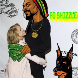 Snoop Lion. In The House. Not in Katie's arms, but you get the drift. He performs today with daughter Cori B!