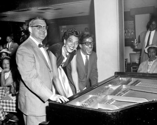 Sammy Davis, Jr. with talk show host Sam Levenson and tennis legend Althea Gibson at piano at a Bon Voyage party for Ms. Gibson at Birdland Nightclub in New York City. Ms. Gibson was set to leave for Wimbledon in the next few days. Photo by Fred Morgan/NY Daily News Archive via Getty Images.