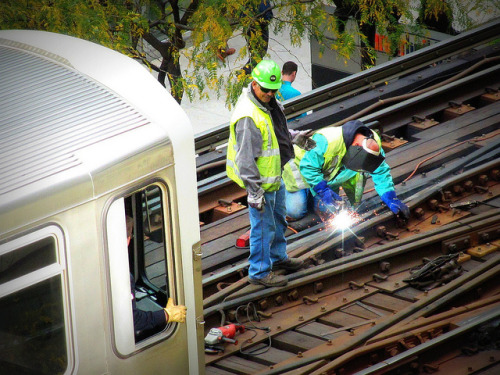 On average 658,524 people ride the 'L' each weekday - the work must always go on. by clarkmaxwell on Flickr.