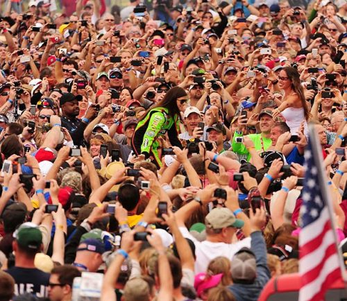 Danica Patrick greats the throng of fans on her way to her car before the 55th running of the Daytona 500 on Feb. 24. Patrick became the first woman to win the pole at a NASCAR Sprint Cup Series event, and she finished eighth in the race. That was the best ever finish by a woman at the Daytona 500, and she made history as the first woman to lead a lap in the historic race. (via Leading Off: Pictures of the Week - Photos - SI.com -)