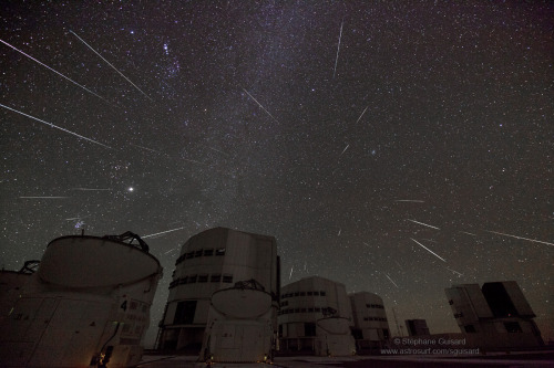 (via APOD: 2012 December 15) When Gemini Sends Stars to Paranal Image Credit & Copyright: Stéphane Guisard (Los Cielos de America), TWAN The ESO, the darkened skies over Paranal Observatory in Chile's Atacama Desert, the Very Large Telescopes (VLT - big buildings in the middle), the Auxiliary Telescopes (for VLT interferometry - short ones that don't look like they have hoods), and the new VLT Survey Telescope (looks like a mini-VLT on the right), all combine to make a great foreground for a shot of the Geminid meteor shower. This multi-exposure, long-shutter (20 seconds) composite points toward the constellation Gemini, so the meteor are streaking very obviously from their radiant. Jupiter is the bright ball on the left, with Orion obvious above it, and the faint trail of the Milky Way in the middle.