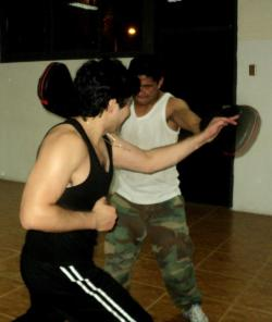 Me and my training partner holding gloves foci .. KALI Eskrima www.ptkchile.cl