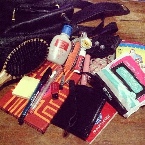 day 14: in my bag 👜 that would be.. hairbrush, notebook, small post-it, ballpens, wallet and license, tissues, alcohol, and a pouch (with flash disk, stylus, nail cutter, earphones, handydandy kutsilyo/bottle opener, lip balmss, and rosaries).. and of course, my phones 😁😋😍 #inmybag #mayphotochallenge