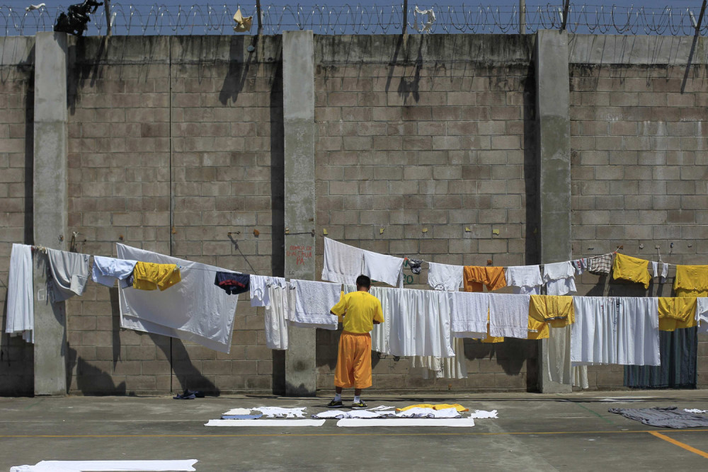 March 5, 2013. A jailed gang member hangs up laundry at the maximum security jail of Izalco in Sonsonate, El Salvador.   (Photo: Ulises Rodriguez—Reuters) From the death of Venezuelan president Hugo Chavez and elections in Kenya to violent protests in Bahrain and International Women's Day around the world, TIME presents the best images of the week. See more of TIME's best pictures of the week.