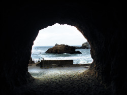 seltaire:   Ocean Beach Sea Cave, San Francisco, CA (more places to go and see)  A sea cave in San Francisco. On the other side is an opening that leads to the ocean. There is another collapsed tunnel with railroad tracks. Wonder what is up with that.