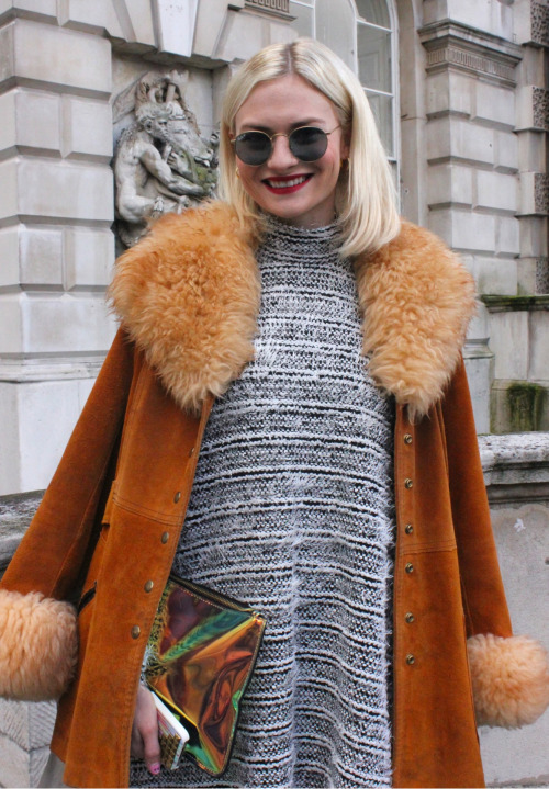 A suede swing coat, roll-neck sweater dress, retro Ray Bans and metallic clutch- contemporary 70s at #lfw  WGSN street shot, London Fashion Week