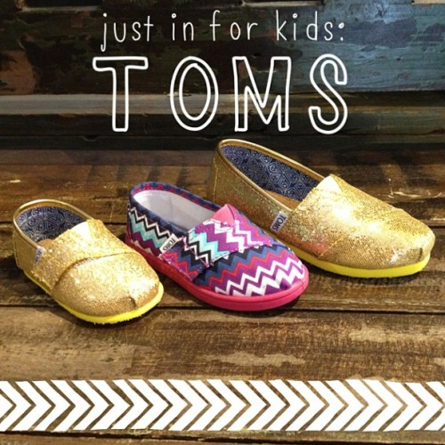 just got a few new kids TOMS! come snag a pair of the #gold #glitter while you can! #TOMS #shoes #oneforone #kids #sparkle #abbadabbas #l5p #fashion
