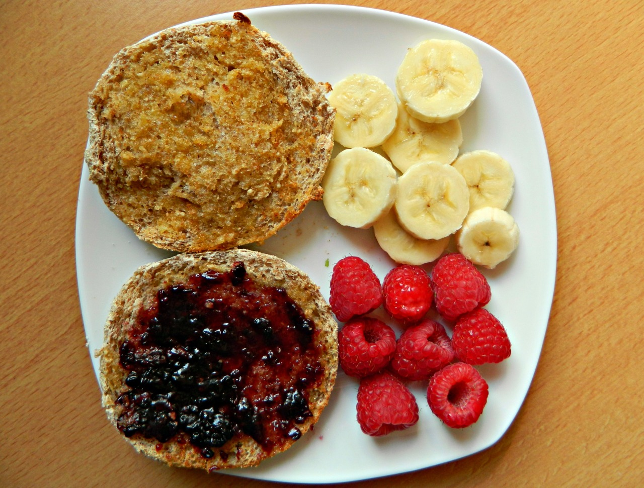 Breakfast - wholegrain English muffin, half with soya butter, half with blackberry jam, banana slices and raspberries.