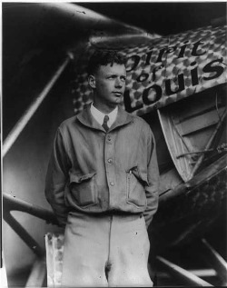 "Charles Lindbergh with ""Spirit of St. Louis"" in background. Copyrighted 1927 (Library of Congress)."