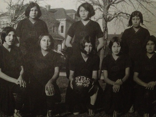 nitanahkohe:  The 1928-29 girls' basketball team at Flandreau Indian School; Bertha Wooden Knife (kneeling, center) was a renowned horsewoman. Nellie Star Boy is standing behind her—Nellie would go on to become a well-respected artist:  Nellie Star Boy Menard was born in 1910 on the Rosebud Reservation of South Dakota. While still a teenager studying at Flandreau Indian School, she was awarded a Pendleton robe for the blanket design that she had submitted to Pendleton Woolen Mills in Pendleton, Oregon. After graduating in 1929, she was invited back to the school as a teacher of Indian arts. Although Menard was never officially credited, she is widely known as the collector of most of the Sioux designs in the historic 1935 book Quill and Beadwork of the Western Sioux by Carrie Lyford. In 1937, Menard started the Arts and Crafts Shop in Rosebud out of a concern for the vitality of Lakota arts and for the economic well-being of Lakota artists. In 1941, she was one of four Indian representatives selected from across the nation as delegates to the Museum of Modern Art and the Museum of the American Indian in New York City. Menard operated the Arts and Crafts Shop in Rosebud until 1942, when she moved to Browning, Montana, to manage Northern Plains Arts and Crafts. After World War II, she returned to South Dakota, where she was employed by the federal Bureau of Indian Affairs in Rapid City. She kept this position for the next 30 years, and attracted considerable attention for her mastery in quiltmaking. Her other artistic skills included featherwork, tanning, quillwork, beading, crochet, and the making of handwoven shawls. In addition, she worked as a manager of craft sales and as a curator, with the responsibility of purchasing items from other craftspeople for resale and for selecting objects for museum display. In this capacity, she was highly regarded, demonstrating a deep knowledge of Native American values and traditional artistic standards.