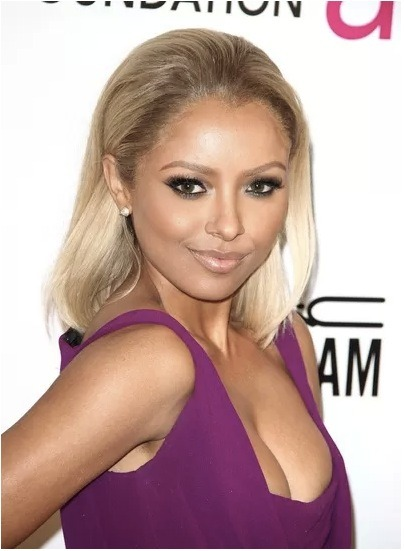 Kat Graham of The Vampire Diaries goes blonde for Elton John's charity Oscars viewing event. What do you think? Love or hate the new hairstyle?
