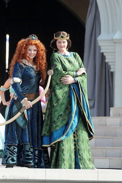 Merida and her mother Queen Elinor stand together after Merida is crowned a Disney Princess.