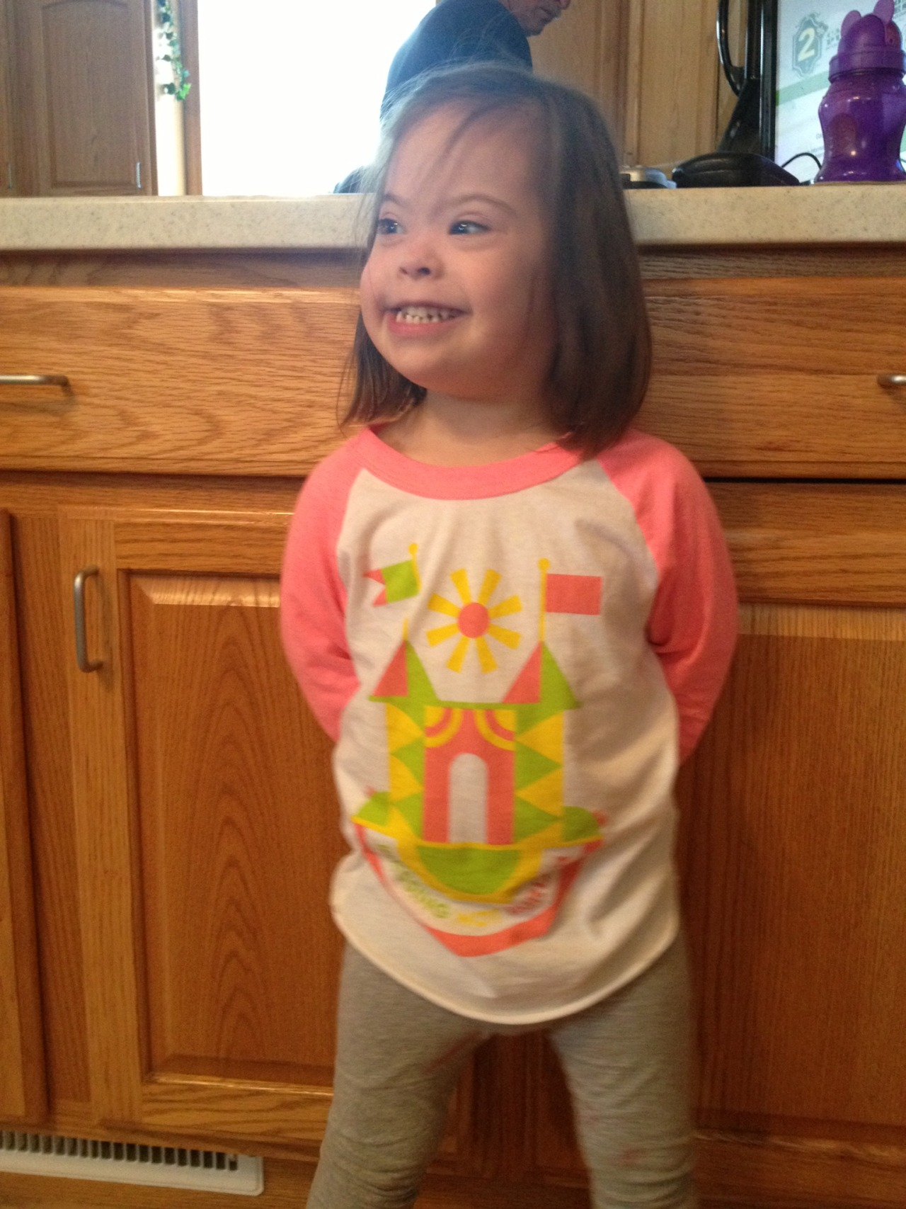 "Hey Sevenly family… meet Adi! Isn't she ROCKING her ""Blessing not Burden"" shirt? :)"