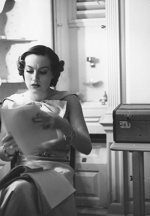 steamboatbilljr:  Joan Crawford studies on the set of No More Ladies, 1935