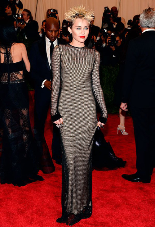 Miley Cyrus in Marc Jacobs Best Dressed at the Red Carpet of Costume Institute Gala for the 'PUNK: Chaos to Couture' exhibition at the Metropolitan Museum of Art 2013. May 7th, 2013 8:34  P.M. GMT.