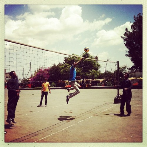 Mechanics and drivers play volleyball during a break at the bus depot in Addis Ababa, Ethiopia. Photo by Jane Hahn @janehahn #addisababa #ethiopia #volleyball #air #iphoneonly #sport