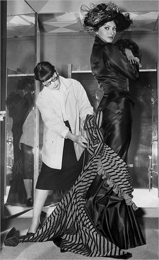 "collectivehistory:  Edith Head, Hollywood's most-decorated costume designer, fits Sophia Loren for her role in 1960's ""Heller in Pink Tights."""