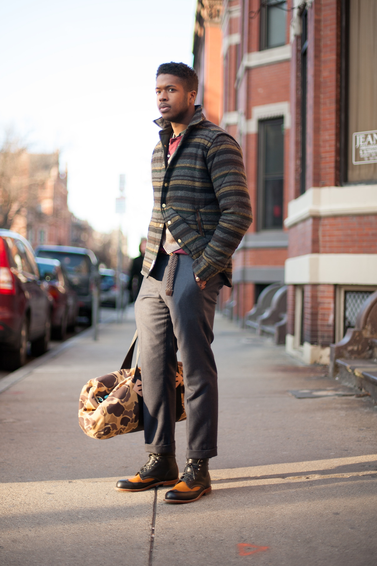 Self Described Style: Mixture of Urban & Gentleman'sFavorite Store in Boston: Bobby From BostonOccupation: Ball and Buck | BloggerSpotted at: Newbury St. I am always excited to see what Edem is wearing. His take on menswear is classic but also really fresh and never boring. We got a chance to work with him more closely when we shot the Ball and Buck store profile and I was happy to run into him on Newbury this afternoon for yet another super sharp look. I love the boots and the bag together. And that jacket adds such great color and texture and is paired so beautifully with his gray pants.